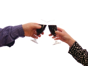 Couple touching glasses of red red wine